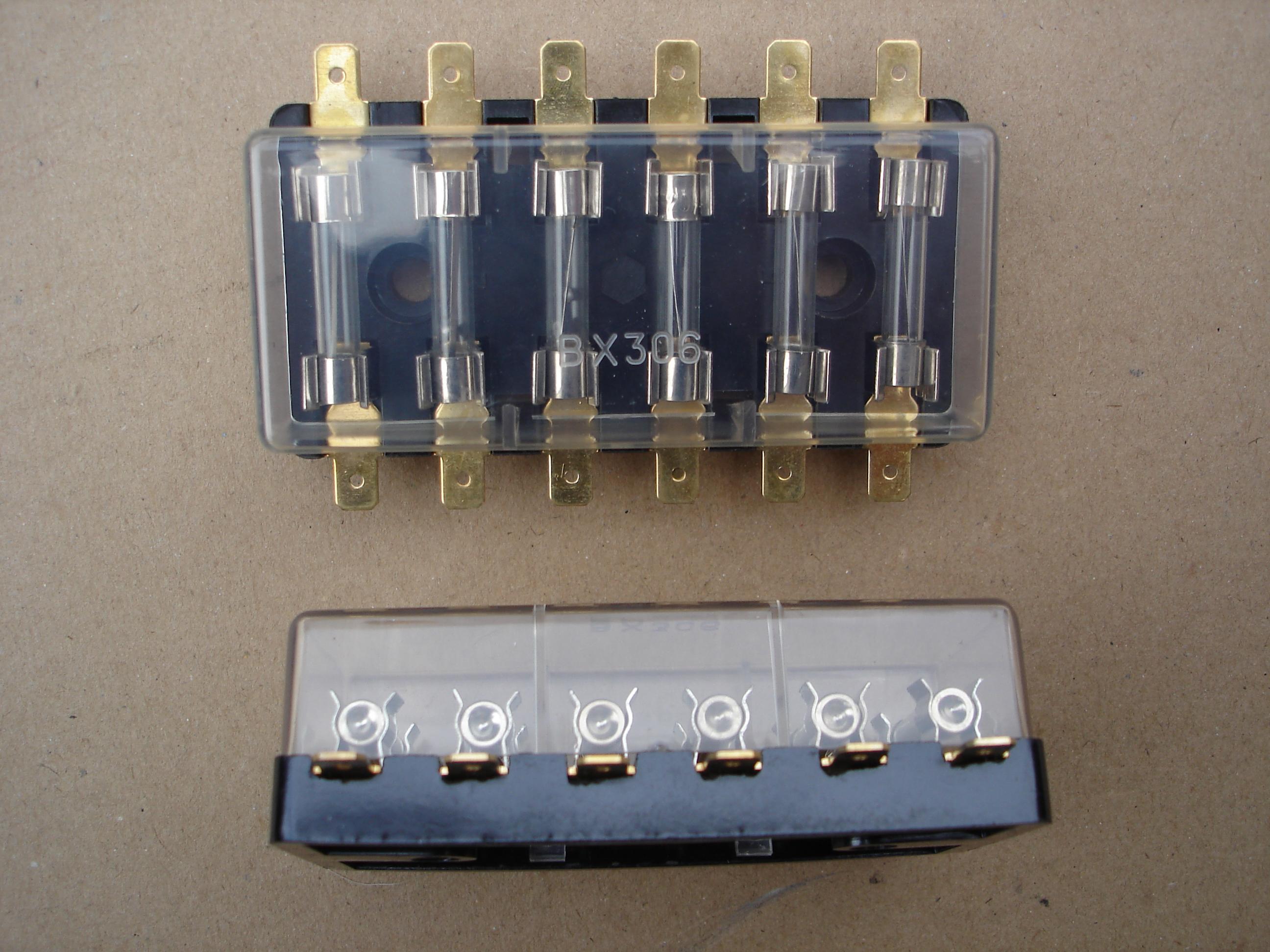 classic fuse box  takes 6 glass fuses, lucar crimp terminals  transparent  perspex clip on cover  measures 94mm x 44mm x 28mm